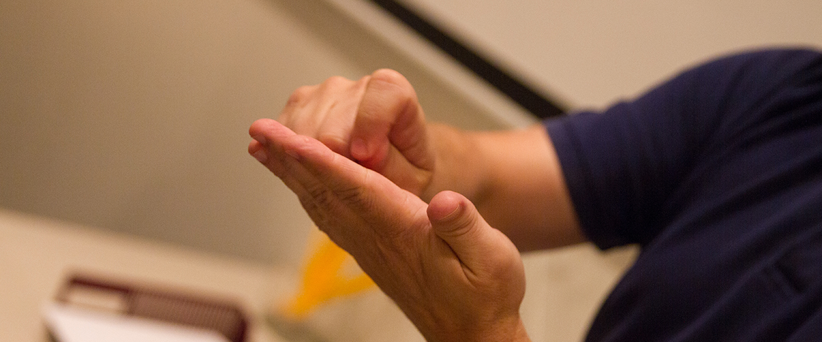 a close up of an interpreters hands